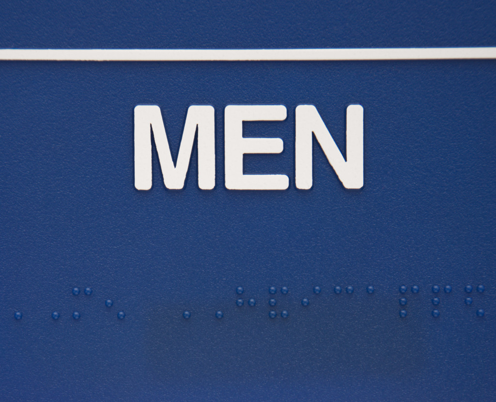 Blue men sign with braille.
